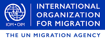 International Organizational for Migration (The UN Migration Agency) text on blue logo