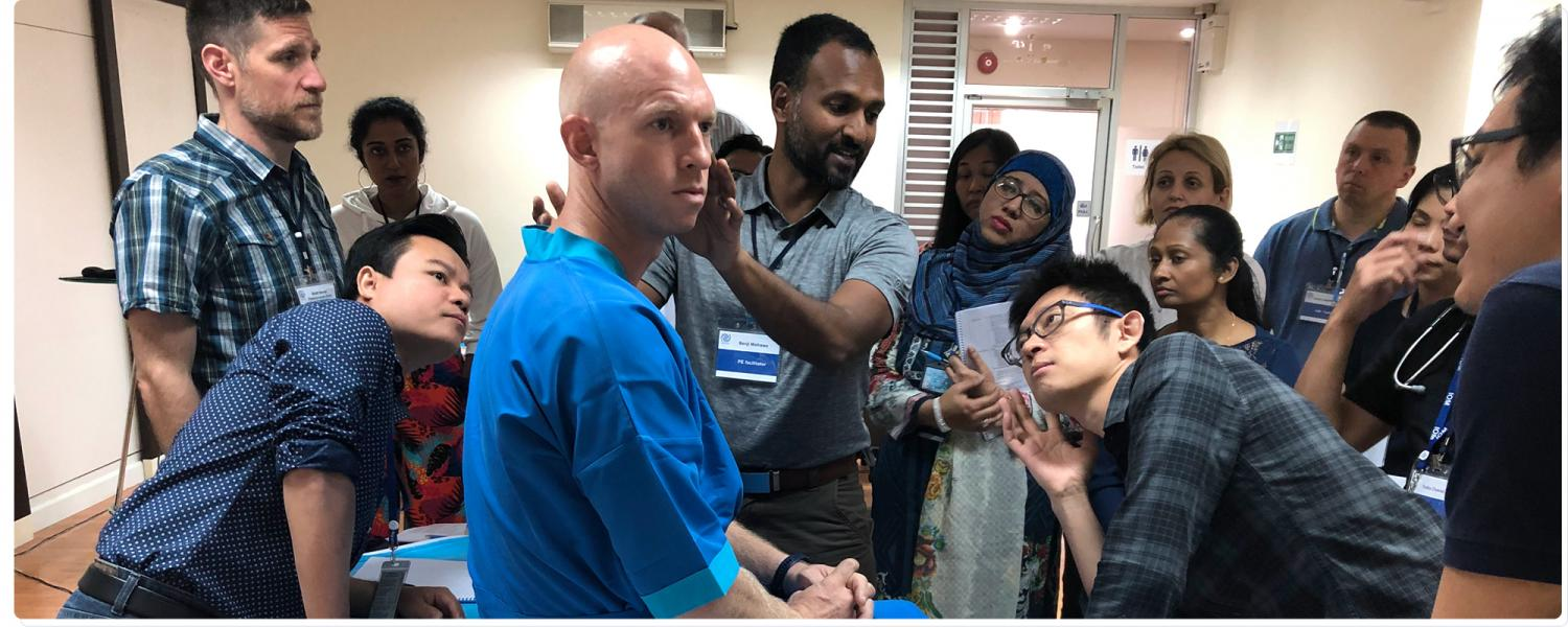 Physician students learning how to do a physica examination
