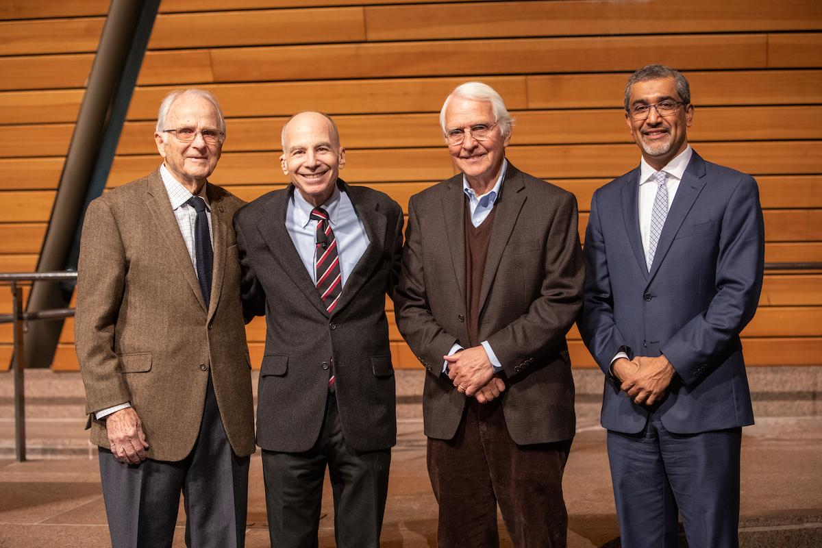 4 men posing for a photo