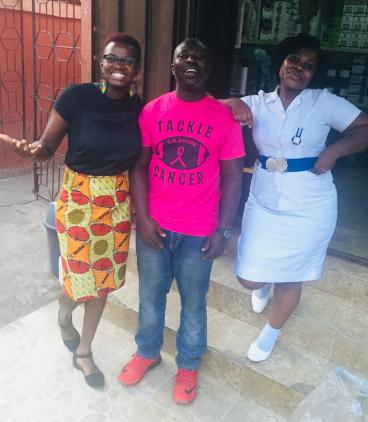 Waruiru Mburu (left) and Nurse Joan (right), who assists with recruitment and interviews, pose with Kwadwo (center), transcriber, before they discuss the days interviews in preparation for the transcription.